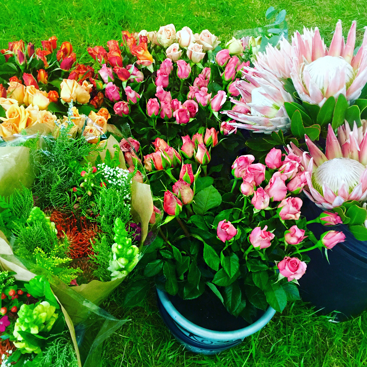 Bunches of roses and proteas